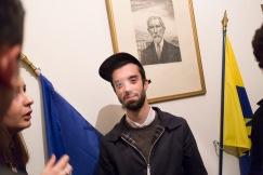 9 octobre 2015, Paris, France. Fabien est le graphiste de l'Action Française. Il fume une cigarette après une conférence et discute avec des amis devant le portrait de Charles Maurras et les drapeaux français et de l'Action Française. Il est un militant très nationaliste. Issu d'une cité de banlieue parisienne, il milite pour une France où la préférence nationale prime. Il a du arrêter l'école à 16 ans pour travailler et participer au frais du foyer. Il paie en partie les études de son frère Leur père ne vit pas avec eux.