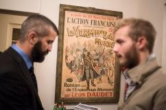 """9 octobre 2015, Paris, France. Dans les locaux de l'Action Française, une vielle affche du quotidien """"L'Action Française""""."""