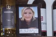 """27 janvier 2017, Lyon (69), FRANCE. Photo dédicacée par Marine Le Pen dans la Traboule, le bar associatif du mouvement d'extrême droite Génération identitaire, alors que la présidente du Front National nie les liens avec ce groupe. Arnaud Delrieux, président de Génération Identitaire France, me dit """"laisse la tranquille"""" en me voyant la photograhier."""