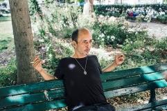 "2019, Thomas is 47 years old? Schizophrenic, he has been admitted for one year in Saint-Anne hospital following some disorders and then has returned to his life outside. 19 juillet 2019. Thomas dans le parc : ""Il y a une époque, je ne t'aurais pas parlé. Là, j'ai fait de gros progrès."""